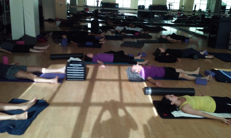 Active Sports Club Yoga Class with 20 Yoga Students in Savasana