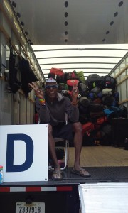 AIDS/Lifecycle Cyclist Tony Eason sitting on gear truck