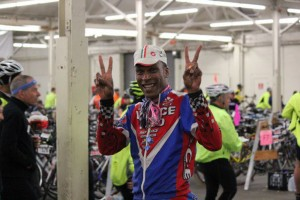 ALC Cyclist Tony Eason gives a piece sign.