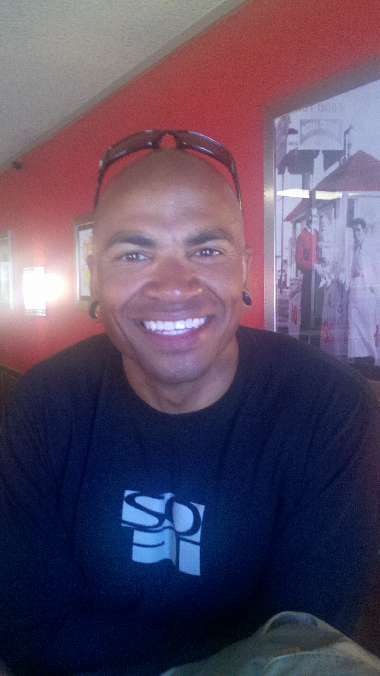 Cyclist Ramon Bostic smiles for camera.