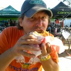 AIDS/Lifecycle Bike Tech eatting a burger
