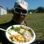 AIDS/Lifecycle Cyclist Tony Eason eatting dinner