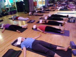 Crunch Yoga Students in Savasana