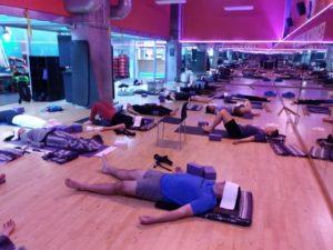Crunch Fitness Yoga Students in Savasana