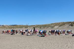 Yoga students outdoor yoga on Ocean Beach SF