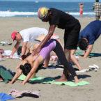 Yoga Teacher Tony Eason gives adjustment