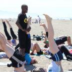 Yoga teacher teaches free yoga class