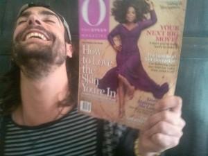 Tony Eason holding Oprah Winfrey Magazine