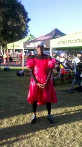 ALC cyclist wearing a red dress