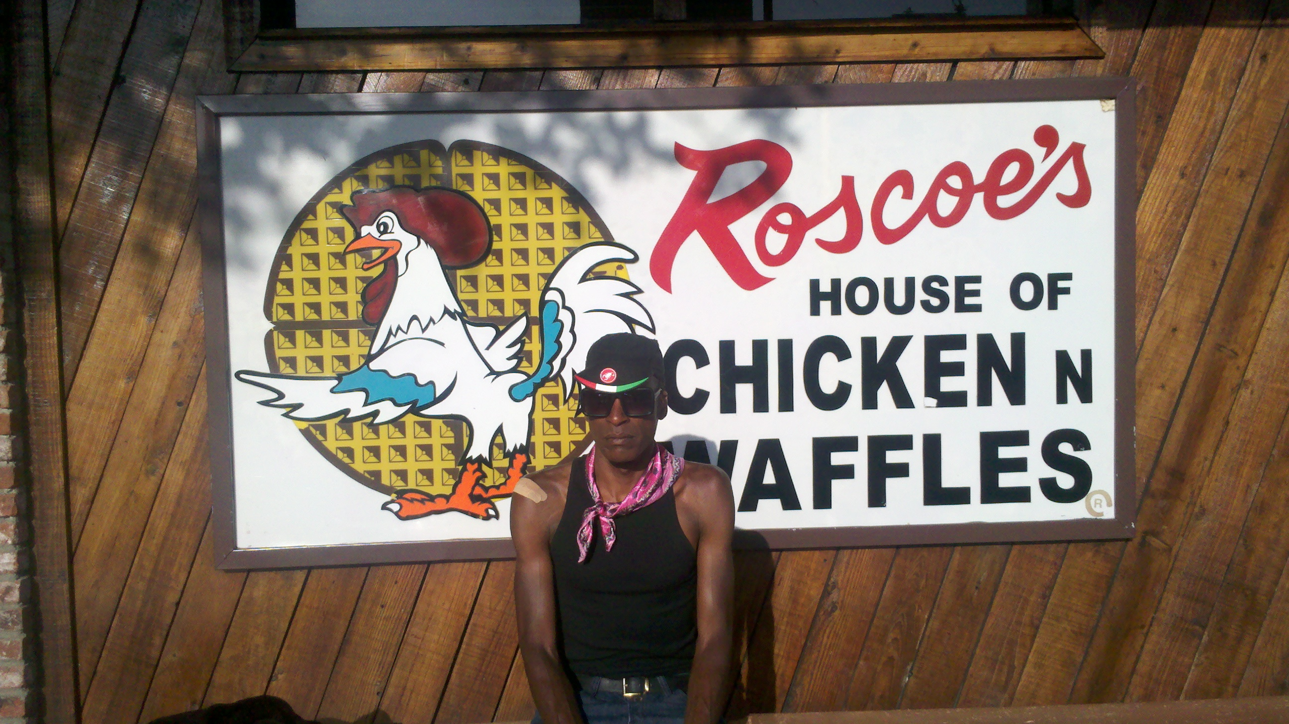 Tony Eason standing in front of Roscoe's House