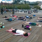 Yoga students doing Savasana Yoga Pose
