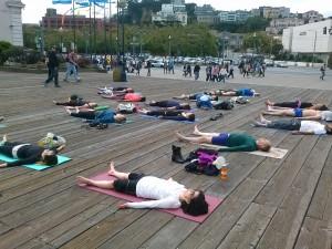 Yoga students doing Savasana Yoga Pose