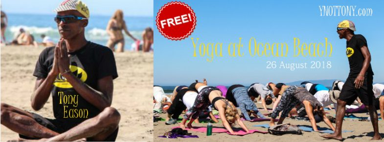 Yoga Students and Yoga Teacher doing yoga on San Francisco's Ocean Beach.
