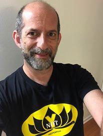 Rabbi wears the Ynot Tee Shirt.