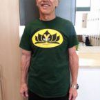 Yoga student wears the Ynot Tee Shirt in Green.