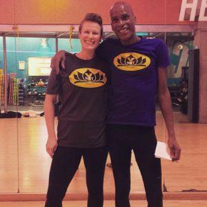 Two yoga teachers wearing the Ynot Tee Shirt.